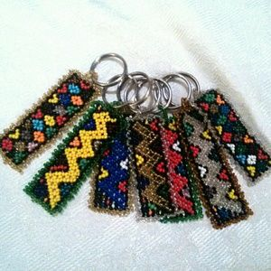 Lot of 8 African Daisy Stitched NOS Keychains